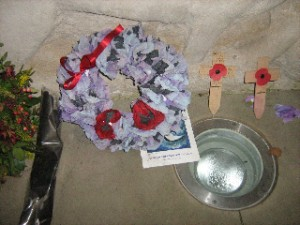 Wreathes and signs of remembrance at the Animals in War memorial